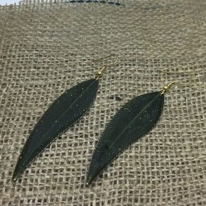 Handmade green glittery leaf earrings